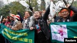 Người biểu tình hô khẩu hiệu chống Trung Quốc trong lễ tưởng niệm 35 cuộc chiến biên giới Việt-Trung tại Hà Nội, ngày 16/2/2014.