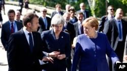 Francuski predsednik Emanuel Makron, britanska premijerka Tereza Mej i nemačka kancelarka Angela Merkel na marginama samita