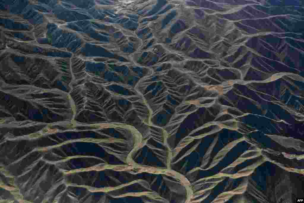 In this aerial photograph, dry river beds snake among the rugged terrain in eastern Afghanistan.