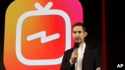 Kevin Systrom, CEO and co-founder of Instagram, prepares for Wednesday's announcement about IGTV in San Francisco, June 19, 2018. Facebook's Instagram app is loosening its restraints on video with a new channel that will attempt to lure younger viewers away from Google's YouTube and pave the way to sell more advertising.