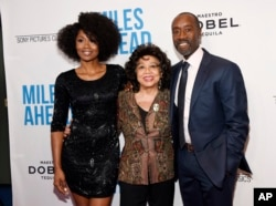 "Don Cheadle, right, the star, director and co-screenwriter of ""Miles Ahead,"" poses with Frances Davis, center, ex-wife of legendary jazz trumpeter Miles Davis, and cast member Emayatzy Corinealdi at the premiere of the film at the Writers Guild Theatre in"
