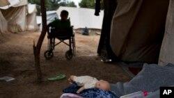 Penaberekî Sûrî li kampên li Yunanistanê