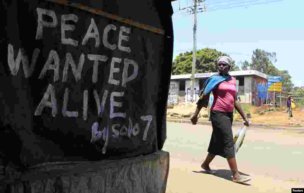 I want to remind Kenyans to vote peacefully in the elections. And to the survivors of the 2007/2008 post election violence, especially those in the Rift Valley region, I say you need to remain positive and hopeful... - James Ruei Majok in Bentiu, Unity state. A woman walks past a message of peace in Kibera slum in the capital Nairobi, February 28, 2013.