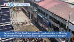VOA60 World - Myanmar: Police fire tear gas and use a tractor to smash through barricades set up by protesters
