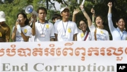 Social activists carry an anti-corruption banner during a rally in Phnom Penh, Cambodia, file photo.