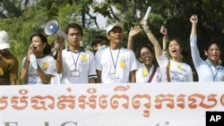 Social activists carry an anti-corruption banner during a rally in Phnom Penh, Cambodia.