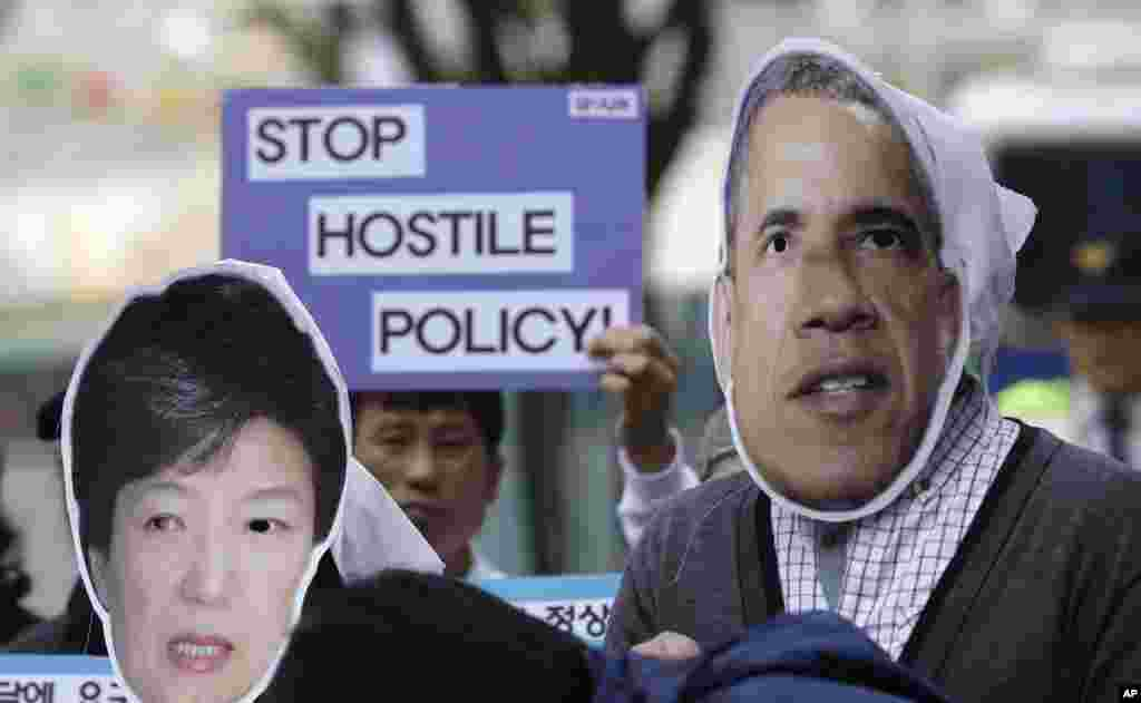 South Korean protesters wear masks of U.S. President Barack Obama and South Korean President Park Geun-hye during a rally denouncing their policy toward North Korea near the U.S. Embassy in Seoul, May 6, 2013.