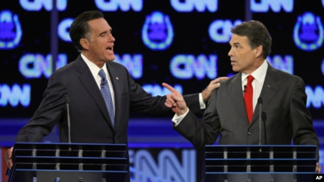 Republican presidential candidates former Massachusetts Gov. Mitt Romney, left, and Texas Gov. Rick Perry argue during a Republican presidential debate in Las Vegas, October 18, 2011.