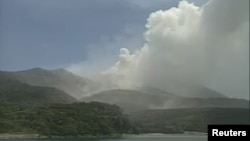 A video grab from the Japan Meteorological Agency's live camera image shows an eruption of Mount Shindake on Kuchinoerabujima island, Kagoshima Prefecture, southwestern Japan, May 29, 2015.