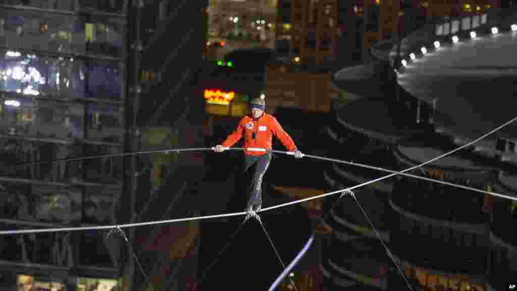 Nik Wallenda walks over the Chicago River uphill nearly eight stories for Discovery Channel's Skyscraper Live with Nik Wallenda, Nov. 2, 2014.