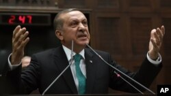 Turkey's Prime Minister Recep Tayyip Erdogan addresses his supporters at the parliament in Ankara, Jan. 14, 2014.