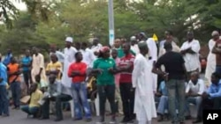 After casting ballots, Voters wait at their polling station in Abuja to hear the results
