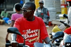 This shirt worn by a motorcycle taxi driver in Makeni, Sierra Leone, may qualify for repatriation, but Project Repat insists they won't take a t-shirt off anyone's back