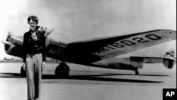 Amelia Earhart, 39, stands next to a Lockheed Electra 10E, before her last flight in 1937 from Oakland, Calif., bound for Honolulu on the first leg of her record-setting attempt to circumnavigate the world westward along the equator.
