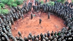 FILE - African Union Mission in Somalia (AMISOM) troops gather for a briefing before embarking on an operation.