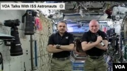 Russian cosmonaut Mikhail Kornieko (L) and U.S. astronaut Scott Kelly live during the interview, Jan 20, 2016.