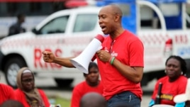 Chidi Odinkalu, chairman of Nigeria's National Human Rights Commission, addresses a gathering of people at a speak-out session of a #BringBackOurGirls rally in Lagos, Nigeria, June 7, 2014.