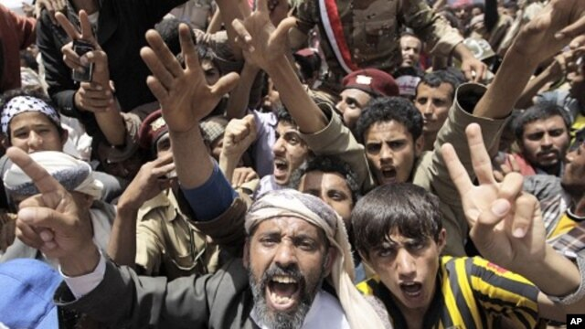 Anti-government protesters shout slogans during a rally to demand the ouster of Yemen's President Ali Abdullah Saleh outside Sana'a University, April 1, 2011