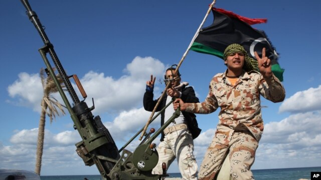 FILE - Libyan militias from towns throughout the country's west parade through Tripoli, Libya, Feb. 14, 2012.