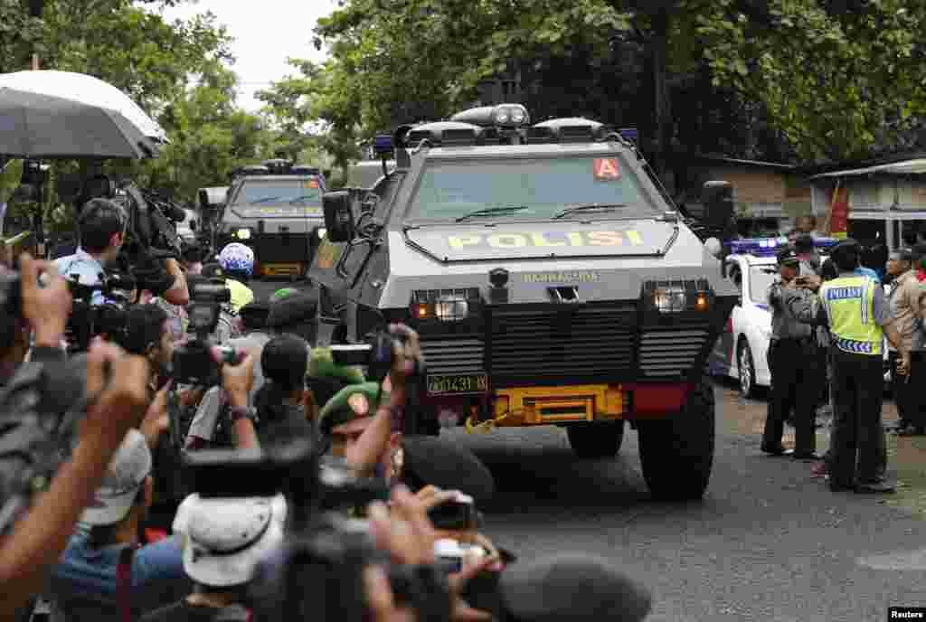 Armored police vehicles believed to be carrying two Australian prisoners, arrives at the port to take a ferry to the prison island of Nusa Kambangan, where upcoming executions are expected to take place, in Cilacap, Central Java, Indonesia. The planned executions of Myuran Sukumaran, 33, and Andrew Chan, 31, have ratcheted up diplomatic tensions between Australia and Indonesia following repeated pleas of mercy for the pair, who are among 11 death row convicts scheduled to go before a firing squad.