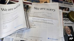 "Newspapers at a news vendor in central London, with the advertisement apology for News International, July 16, 2011. News Corporation chairman Rupert Murdoch signed the company advert entitled ""We are sorry"", which appears in British national newspapers."
