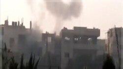 آرشیو: در ایت تصویر که از شبکه شمس گرفته شده، دود برخاسته از تیراندازی ها در حمص را می بینید. اول دی ماه ۱۳۹۰ (۲۲ دسامبر ۲۰۱۱)