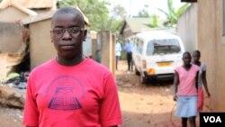 FILE - Phiona Mutesi stands near where she grew up in Katwe, Kampala, Uganda, Jan. 28, 2012. (H. Heuler/VOA)
