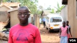 Phiona Mutesi stands near where she grew up in Katwe slum, Kampala, Uganda, January 28, 2012. (H. Heuler/VOA)