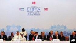 Fatih Mohammed Baja (L), Advisor of Political Affairs to Head of National Transitional Council of Libya, Khalid Al Ghaith (2nd L), United Arab Emirates (UAE) Assistant Minister for the Department of Economic Affairs, Turkish Foreign Minister Ahmet Davutog