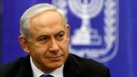 FILE - Israel's Prime Minister Benjamin Netanyahu attends a Likud-Beitenu faction meeting at parliament in Jerusalem, February 5, 2013.