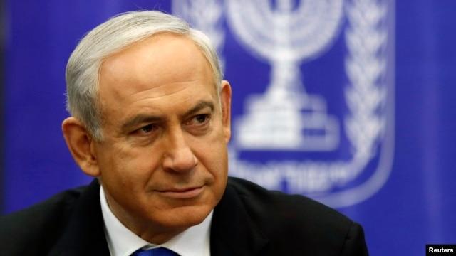 FILE - Israel's Prime Minister Benjamin Netanyahu attends a Likud-Beitenu faction meeting at parliament in Jerusalem, February 5, 2013.