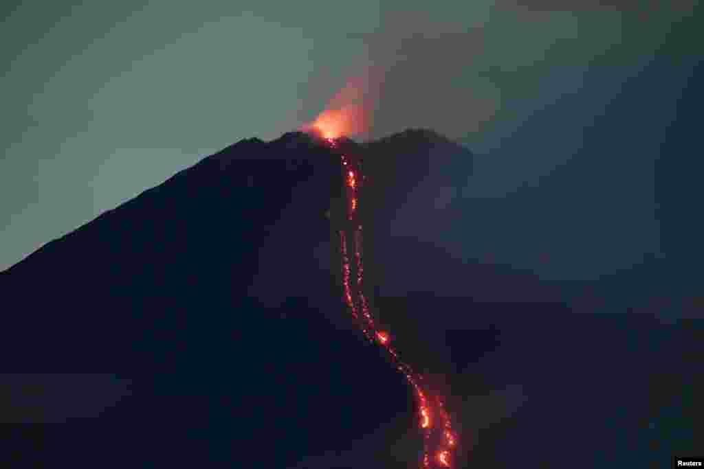 Mount Semeru volcano spews hot lava as it erupts, as seen from Oro-oro Ombo village in Lumajang, East Java province, Indonesia. (Credit:Antara Foto)
