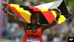 Uganda's Stephen Kiprotich celebrates after crossing the finish line to win gold in the men's marathon at the 2012 Summer Olympics Sunday, Aug. 12, 2012 in London. (AP Photo/Anja Niedringhaus)