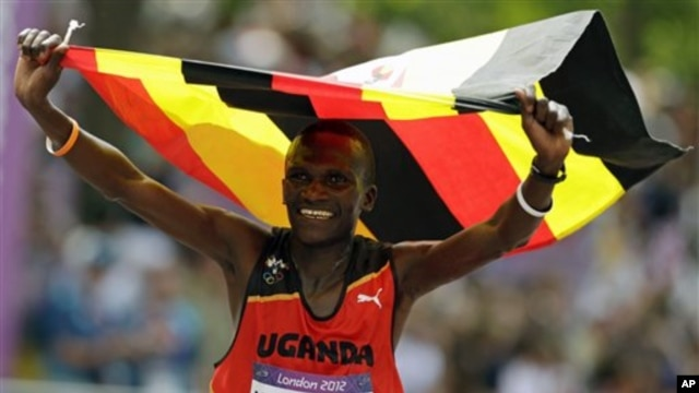 Uganda's Stephen Kiprotich celebrates after crossing the finish line to win gold in the men's marathon at the 2012 Summer Olympics