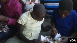 Some girls seen sewing re-usable sanitary pads in Zimbabwe. (Photo: VOA)