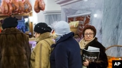 Customers line to stock up for the New Year in GUM Department Store in Red Square in Moscow, Russia, Dec. 29, 2015. Consumer food prices have increased faster than the average rate of inflation: 15.5 percent.