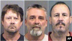 These Oct. 14, 2016 booking photos provided by the Sedgwick County Sheriff's Office in Wichita, Kansas, show, from left, Patrick Stein, Gavin Wright and Curtis Allen. They are members of a militia group and charged with plotting to bomb an apartment building housing Somali refugees in Garden City, Kansas.