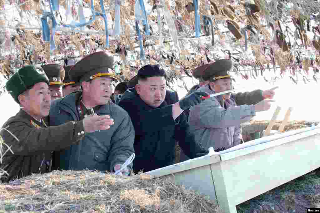 North Korean leader Kim Jong Un visits the Wolnae Islet Defence Detachment in the western sector of the front line, which is near Baengnyeong Island of South Korea, March 11, 2013. (KCNA)