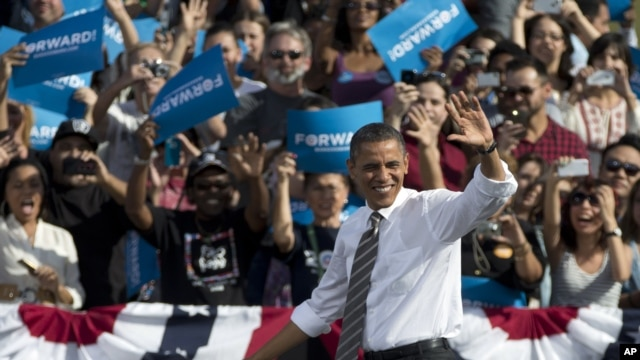 President Barack Obama waves to the crowd as he arrives to speak at a campaign event, Nov. 1, 2012, at the Cheyenne Sports Complex in Las Vegas.