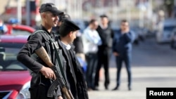 Egyptian security personnel guard the entrance to the Bella Vista Hotel in the Red Sea resort of Hurghada, Egypt, January 9, 2016. Two armed assailants attacked the hotel in the Egyptian Red Sea resort town of Hurghada on Friday, wounding three foreign to