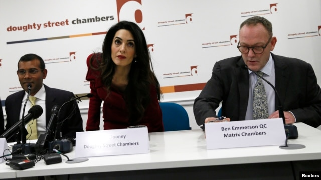 Lawyer Amal Clooney (C) takes her place by Mohamed Nasheed (L) at the start of a news conference in central London, Britain,  Jan, 25, 2016.