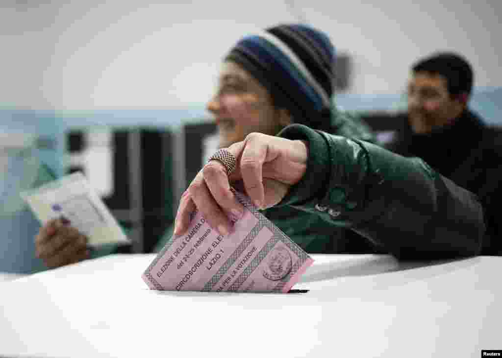A woman casts her vote in a polling station in Rome, Feb. 24, 2013.