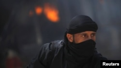 Pobunjenički borci u Siriji