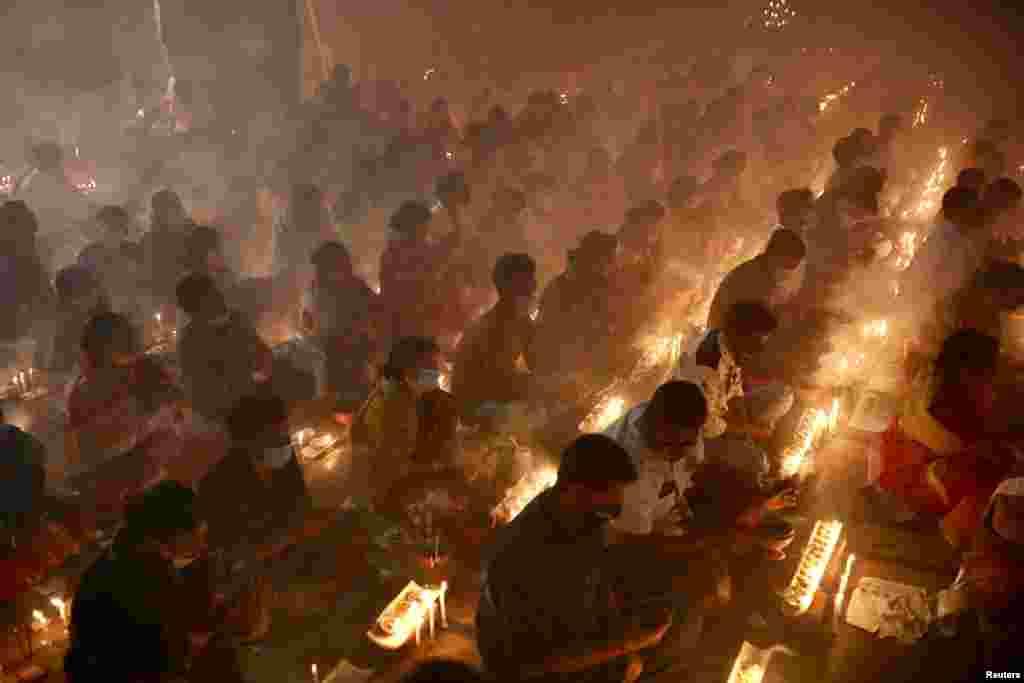 Hindu devotees observe Rakher Upabash in Narayanganj, Bangladesh, Nov. 7, 2020.