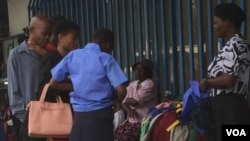 Some school children and their parents looking for school uniforms in Bulawayo streets.