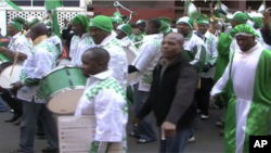 Nigerian fans parade through the Hillsborough neighborhood of Johannesburg before their team's first game in the World Cup tournament.