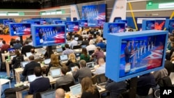 Members of the media view the Republican presidential primary debate hosted by ABC News at the St. Anselm College in Manchester, N.H., Feb. 6, 2016.