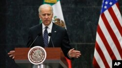 Vice President Joe Biden, left, speaks during a joint news conference with Mexico's President Enrique Pena Nieto at Los Pinos presidential residence in Mexico City, Sept. 20, 2013.