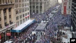 The New York Giants get a tickertape parade as they head up the Canyon of Heroes, Feb. 7, 2012 in New York.