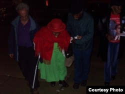 Bakary Tandia and his team of grassroots volunteers help an elderly African American woman get to the polls to vote, in Philadelphia, Pennsylvania, on Election Day 2008. (Credit: Bakary Tandia)